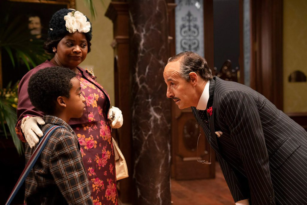 Octavia Spencer (grandma), Stanley Tucci (Mr. Stringer) and Jahzir Bruno in The Witches