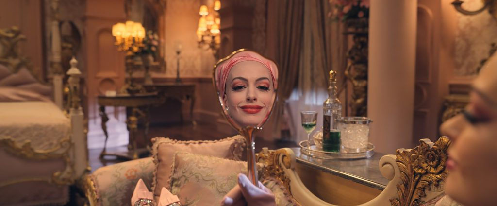 Anne Hathaway looking in mirror in The Witches