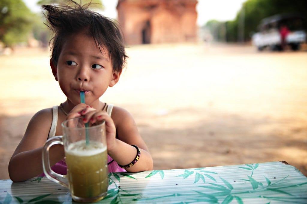 little girl drinking Sugarcane juice