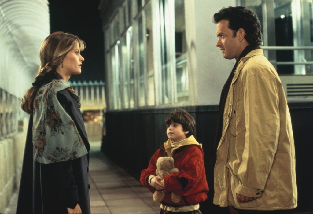 A still from Sleepless in Seattle, featuring Tom Hanks, Meg Ryan, and Ross Malinger.